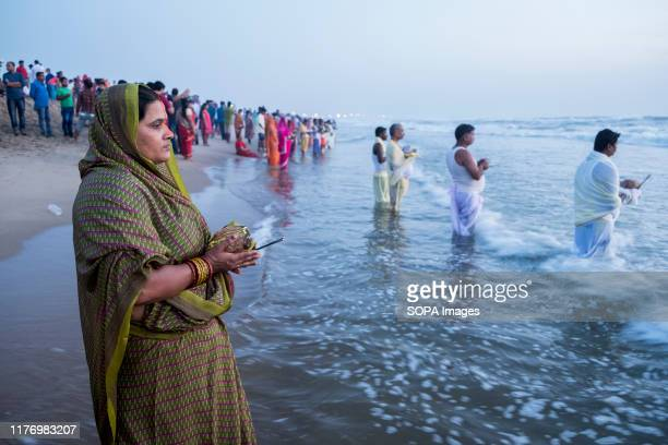 People gather to worship at Marina beach during the festival Chhath Puja is one of the vibrant and colorful festivals of India Mainly Bihari...