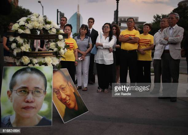 People gather together during a vigil in memory of Chinese Nobel Peace Prize laureate Liu Xiaobo on July 17 2017 in Washington DC Liu died of...