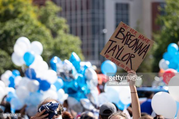 People gather with balloons for a vigil in memory of Breonna Taylor on June 6, 2020 in Louisville, Kentucky. This is the 12th day of protests since...