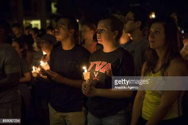 People gather with candles to march along the path that White Supremacists took the prior Friday with torches on the University of Virginia Campus in...