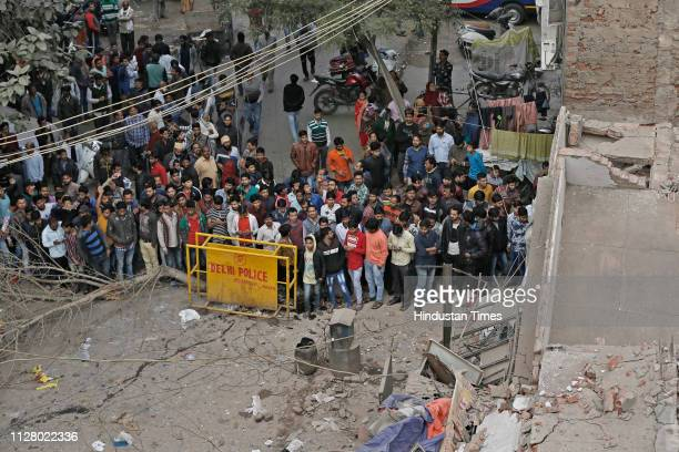 People gathered after a building collapsed during the early hours of morning at Dev Nagar Karol Bagh on February 27 2019 in New Delhi India An old...