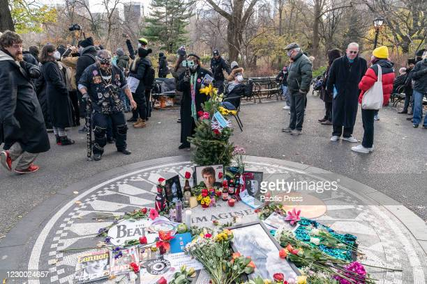 People gathered around Strawberry Field Imagine mosaic in Central Park to remember John Lennon 40 years after his death. John Lennon was killed 40...
