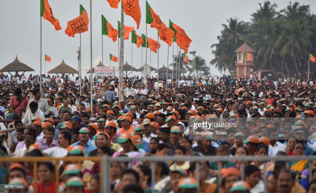 People gathered at Maple beach for BJP national President Amit Shah's speech during Fishermen's convention at Maple beach on February 20, 2018 in Udupi, India. Ahead of the assembly polls scheduled to be held in May, Shah launched the BJPs poll campaign in the communally sensitive Dakshina Kannada and Uttara Kannada districts in coastal Karnataka, where the party has a strong presence and is trying to consolidate it further.