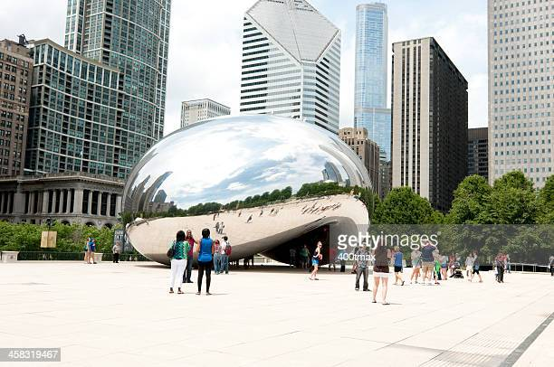 people gathered at millennium park - cloud gate stock photos and pictures
