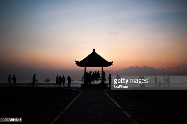 People gathered at Sanur beach waiting for the sun to rise on July 20 2018 on the island of Bali Indonesi