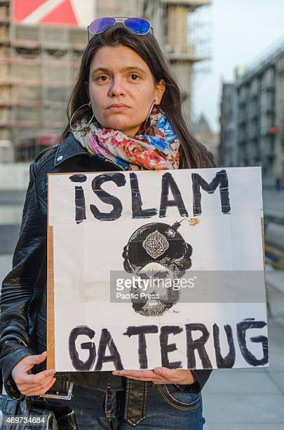 """People gathered at the second meeting of """"PEGIDA Flanders"""" with flags and banners. PEGIDA is a German right-wing organization whose abbreviated name..."""