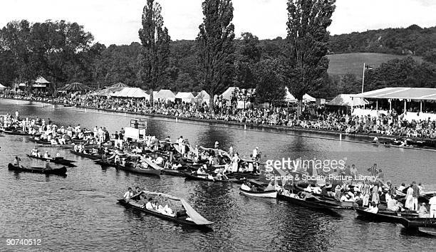 People gathered in punts at the famous Henley Regatta
