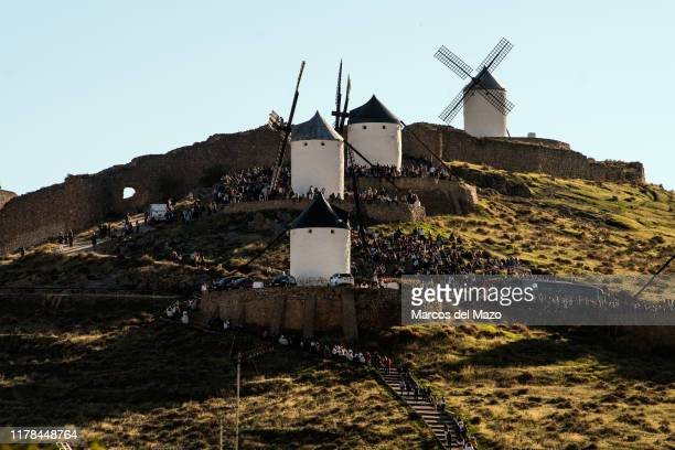 People gathered in traditional windmills during the annual Saffron Festival. Each year Consuegra in Toledo, celebrates the feast 'Fiesta de la Rosa...