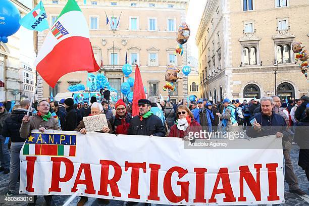 People gathered led by the unions hold balloons and banners as they stage demonstration against government's reforms in the labor market and the...