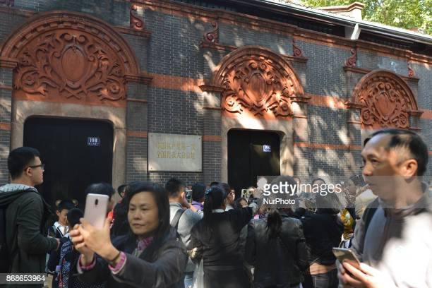 People gathered outside the birthplace of China's Communist Party in Shanghai for a photosouvenir just after President Xi Jinping's symbolic visit...