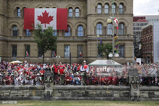People gathered outside the gates of Parliament Hill on Canada Day in Ottawa Ontario Canada on Friday July 1 2016 On July 1 thousands of locals and...