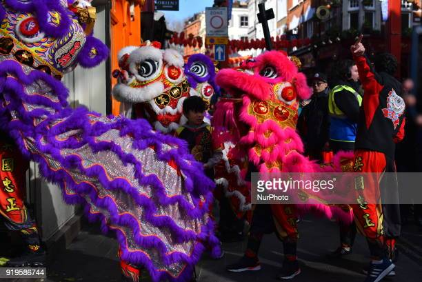 People gathered to celebrate the Chinese New Year in the streets of Londons Chinatown on February 17 2018 The traditional dragon masks enter into the...
