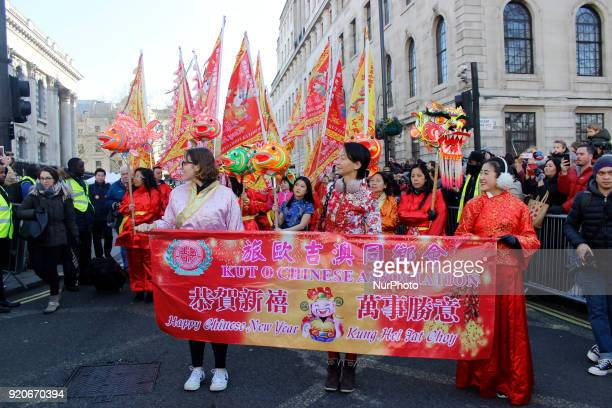 People gathered to celebrate the Chinese New Year in the streets of Londons Chinatown on February 18 2018 The traditional dragon masks enter into the...
