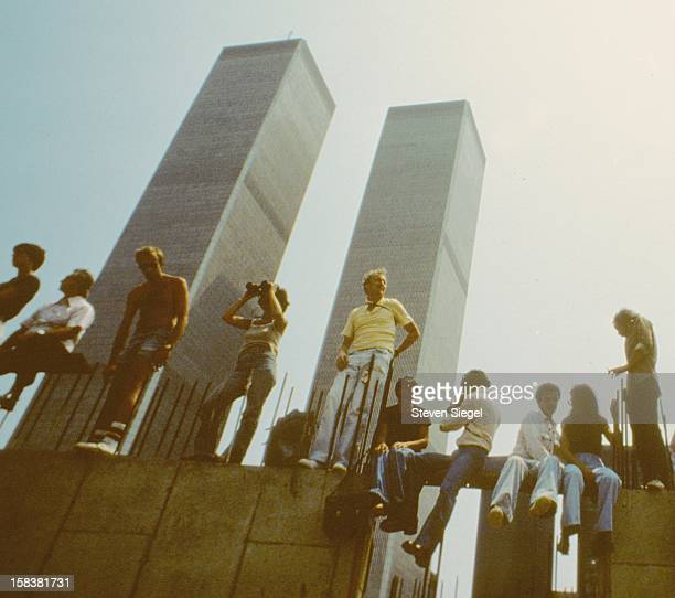 People gathered to watch Operation Sail in New York harbor 1976 The location is the construction site of Battery Park City The World Trade Center had...