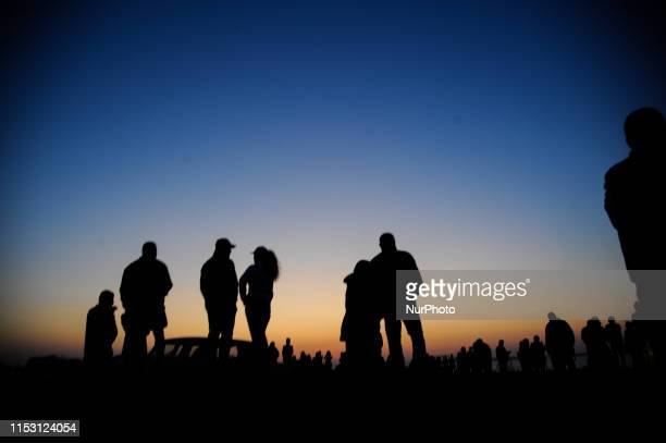 People gathered to watch the sun rising from the sea on July 1 2019 People welcoming the first sunrise of July at the most Eastern part of Bulgaria...