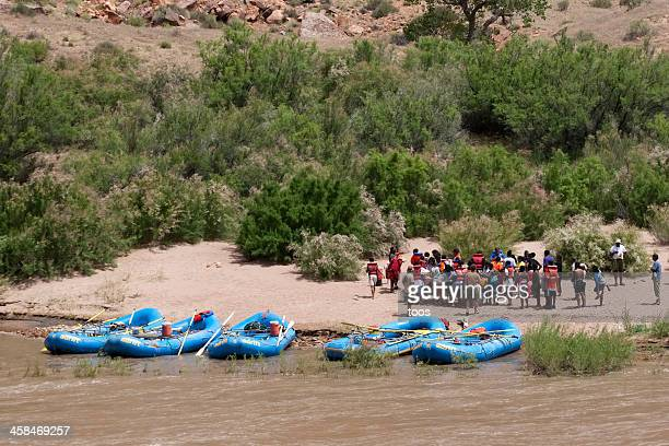 People gathering and receiving white water rafting instructions