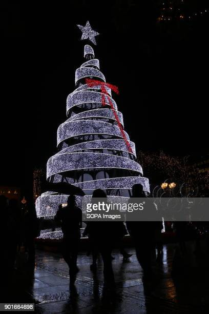 People gathering around the big LED Christmas tree at the heart of Athens Syntagma Square Christmas decorations in Athens lasts from the end of...