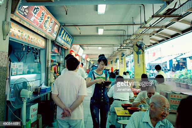 People gathering at an eatery in Chinatown for breakfast.