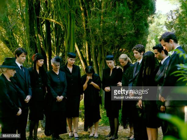 people gathering at gravesite - place concerning death stock pictures, royalty-free photos & images