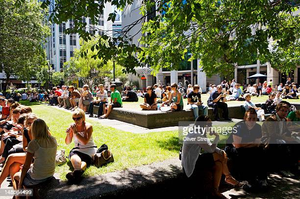 People gathering in Midland Park on a fine sunny day.