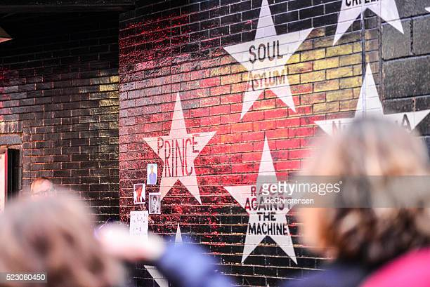 people gathering near prince's star at first avenue - minneapolis stock pictures, royalty-free photos & images