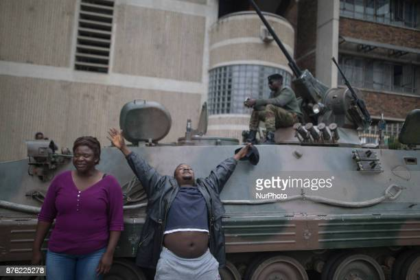 People gesture and shout slogans during a demonstration demanding the resignation of Zimbabwe's president on November 19 2017 in Harare Zimbabwe was...