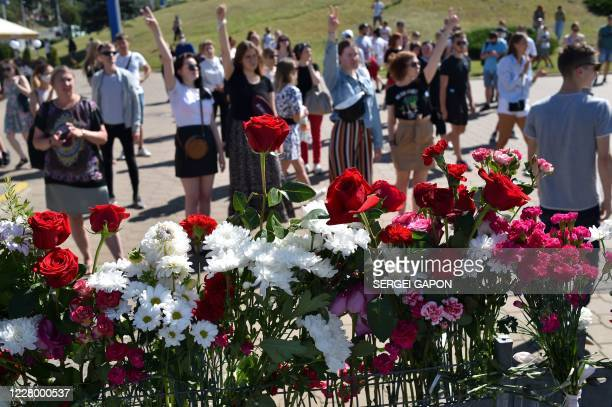 TOPSHOT People gesture during a gathering at the site where a protester died last night in Minsk on August 11 2020 The main challenger in Belarus's...