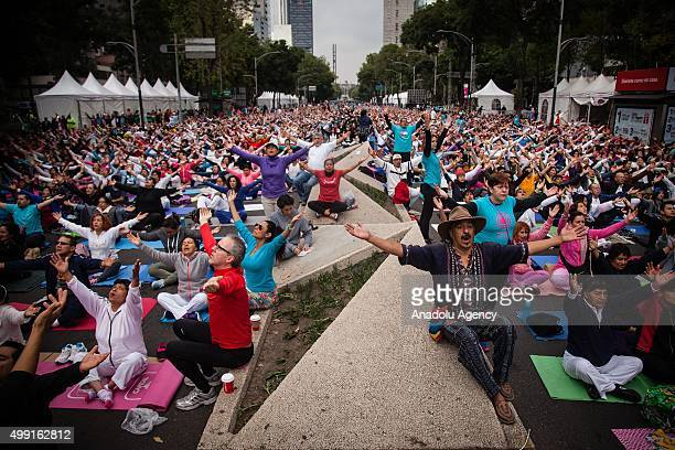 People gestures during a massive yoga class for World Peace where about 10000 people gathered in El Paseo de la Reforma in Mexico City Mexico on...
