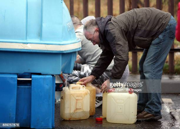People get drinking water at Whiterock leisure centre in Belfast as tens of thousands of homes and businesses are still without supplies as engineers...