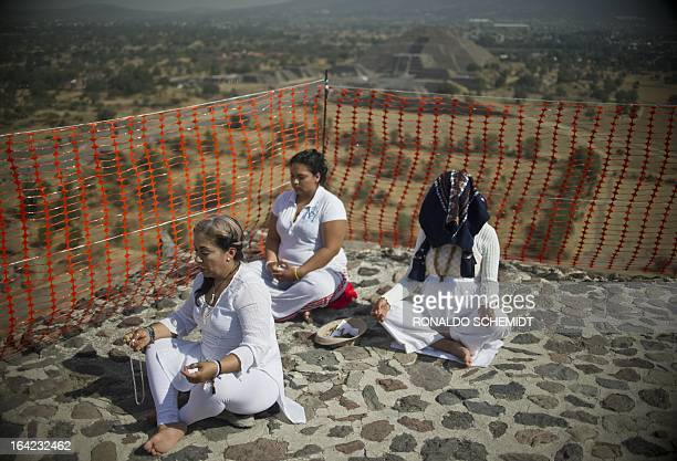 People get energy from the sun atop the Pyramid of the Sun at the archaeological site of Teotihuacan Mexico during the celebrations for the Spring...