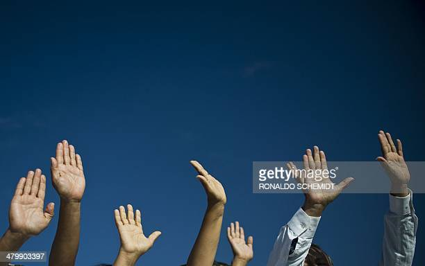 People get energy from the sun atop the Pyramid of the Sun at the archaeological site of Teotihuacan Mexico during celebrations for the Spring...