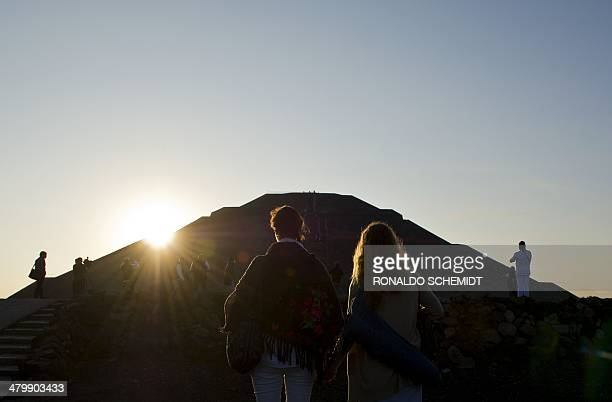 People 'get energy' from the sun in front of the Pyramid of the Sun at the archaeological site of Teotihuacan Mexico during celebrations for the...