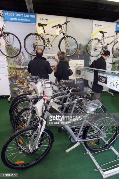 People get information on bikes in a Paris store 13 November 2007 on the eve of a national rail and subway workers strike A Paris store declared to...