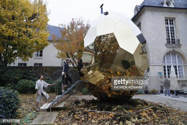 People get inside the eggshaped sauna 'solar egg' designed by artists Bigert and Bergström in the courtyard of the Swedish institute in Paris on...