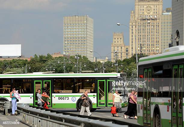 People get on the bus 'free pass' between Slaviansky Boulevard and Park Pobedy after three subway cars derailed on July 15 in Moscow Russia At least...