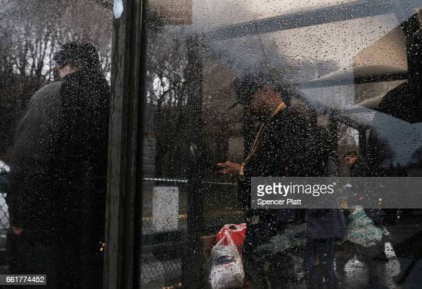 People get onto a bus headed to the jail at Rikers Island on March 31 2017 in New York City New York Mayor Bill de Blasio has said that he agrees...