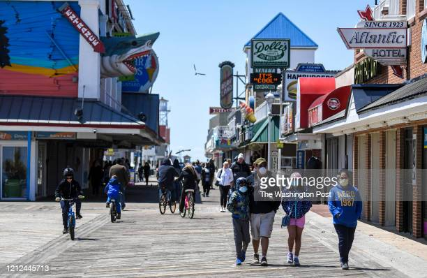People get out on a cold blustery day to walk the Ocean City Boardwalk as Maryland Governor Larry Hogan is reopening some recreation activities in...