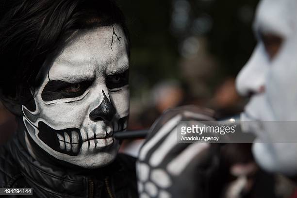 People get ready before Procession of the Catrinas in Mexico City Mexico on October 25 2015 The Catrina is a figure of a skeleton wearing an elegant...