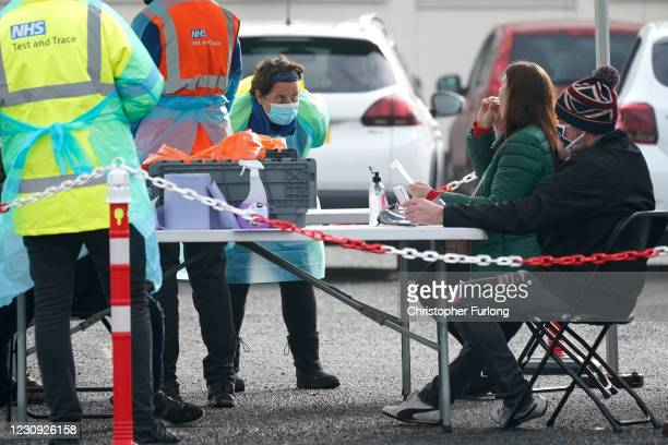 People get tested at a drive in testing station at Walsall Arena and Arts Centre as local authorities prepare to deploy covid-19 testing in an effort...