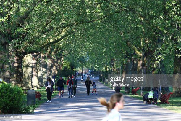 People get their daily exercise in Battersea Park on April 25, 2020 in London, United Kingdom. The British government has extended the lockdown...