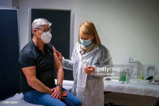 People get vaccinated against COVID-19 at the Cannes Palace of Festivals and Conferences on January 13, 2021 in Cannes, France. The Cannes Palace of...