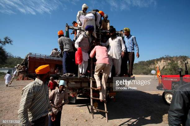 People getting down from truck in Punjab, India