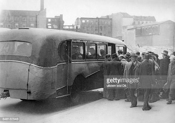 People getting in a inter-zone bus - ca. 1949 - Photographer: Walter Gircke Vintage property of ullstein bild