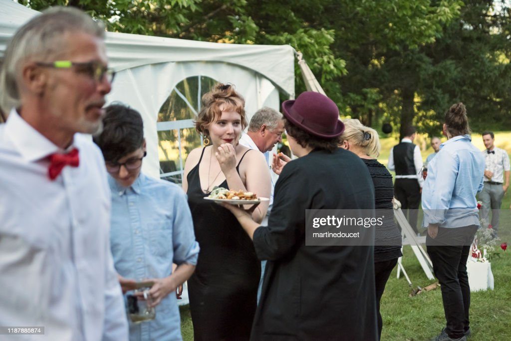 People getting meals from a food truck at a wedding. : Stock Photo