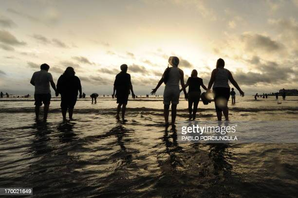 People give offerings to Yemanja the Goddess of the Sea of the AfroAmerican religion Umbanda 02 February 2010 at a beach in Montevideo Thousands of...