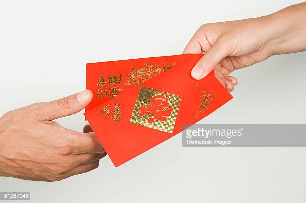 People giving Chinese money envelopes