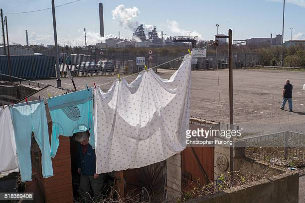 People go about their daily lives as production continues at the Tata Steel plant at Port Talbot on March 31 2016 in Port Talbot Wales Indian owners...