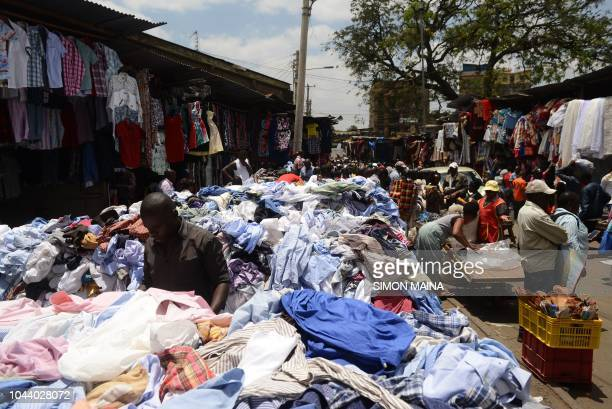 People go about their second hand shopping on October 1 2018 at the busy Gikomba market in Nairobi