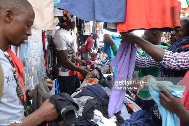 People go about their secondhand shopping on October 1 2018 at the busy Gikomba market in Nairobi Kenya