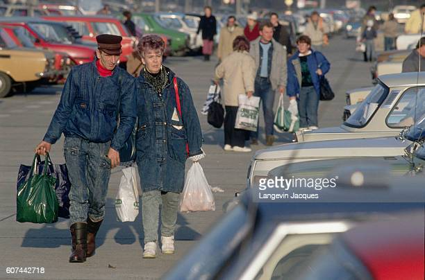 People go back to their cars in Trabant's car park near the airport, after shopping in West Germany after the fall of the Berlin Wall.